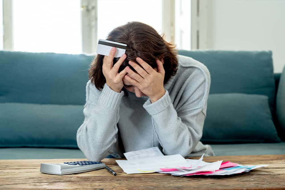woman-stressed-over-bad-credit-and-debt